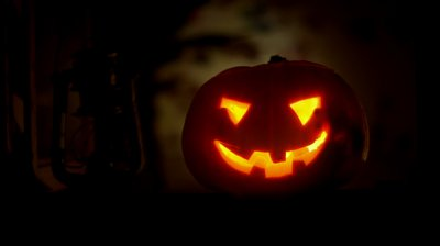 stock-footage-a-scary-halloween-pumpkin-lantern-in-the-window-seamless-loop-clip-id-halloween-n